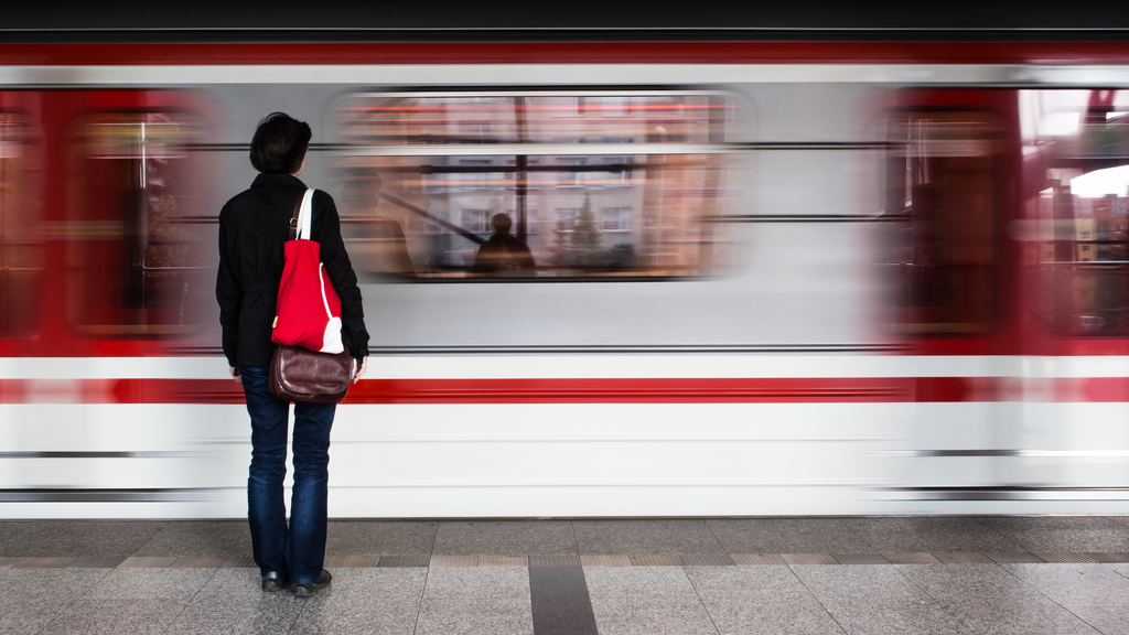 A woman waiting in the metro station