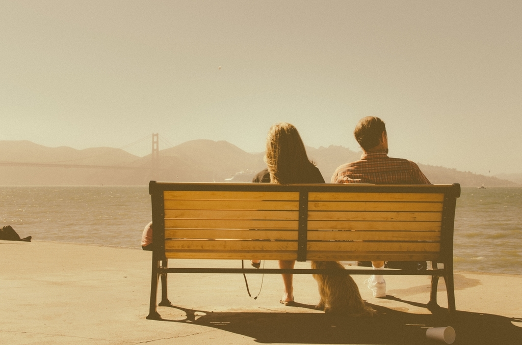 Couple viewing the sea on a bench