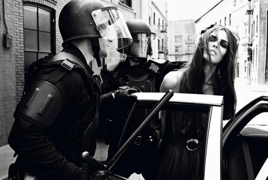 Editorial fashion photo for a girl with the police
