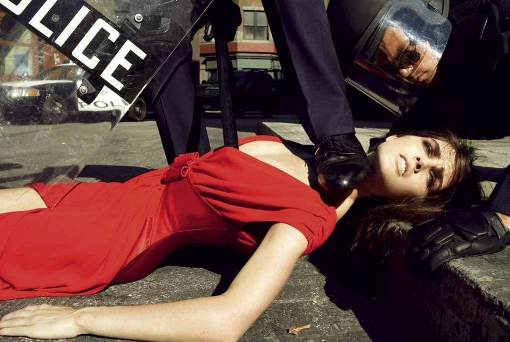 Editorial photo of a model dressed in red arrested by police