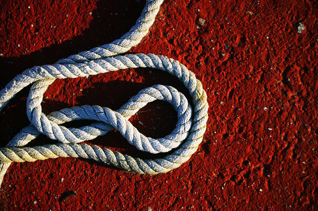 Sailing rope on a red ground background