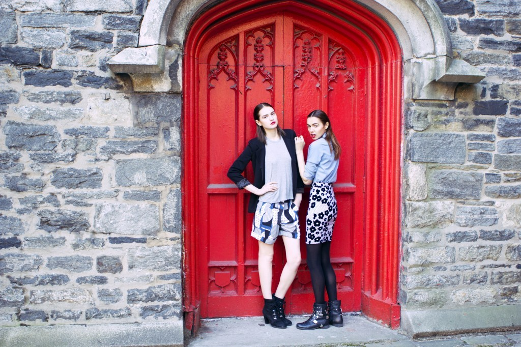 Two models posing next to a red door city dreamers