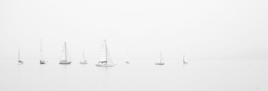 White washed photo of wind boats